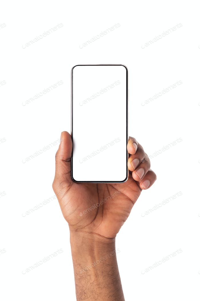 Modern frameless smartphone with blank screen in african man's hand