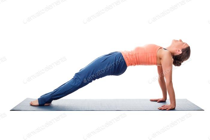 Sporty fit yogini woman practices yoga asana purvottanasana