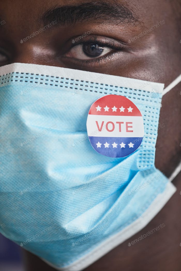 Voter in protective mask