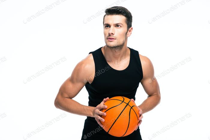 Portrait of a handsome man playing in basketball