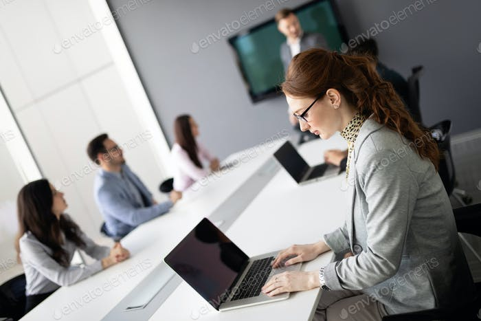 Businesspeople discussing together in conference room during meeting