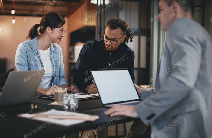 Diverse group of businesspeople meeting together in an office