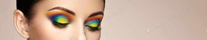 Female eye with  rainbow make-up