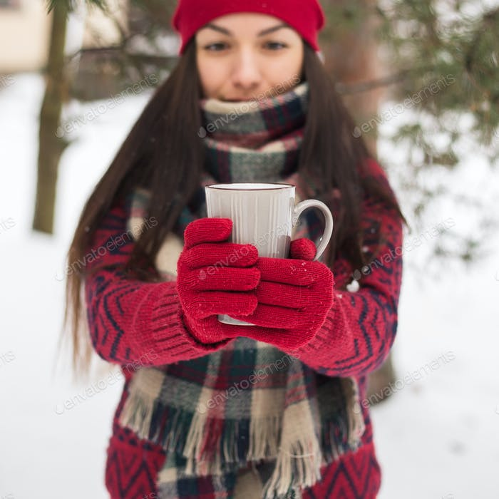 Thumbnail for Beautiful happy smiling woman with a cup in the winter on the street