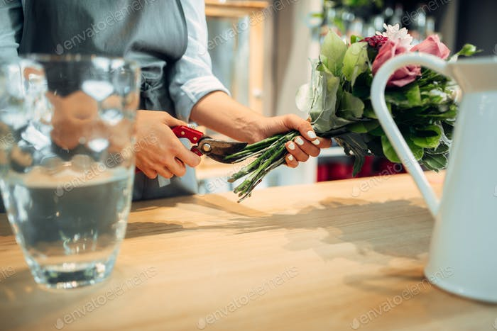 Florist making flowers arrangement in shop