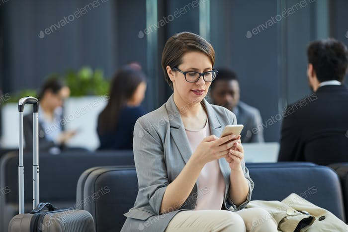 Content lady checking messengers in airport