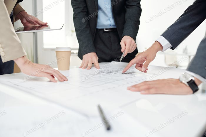 Business People Discussing Construction Plans