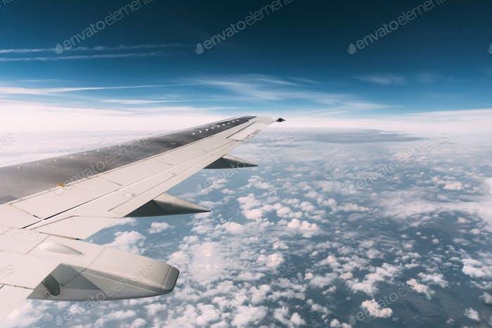 Sky View From Airplane Window. Window Seen Beautiful Sky From He