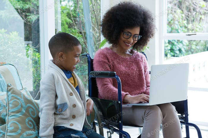 Son and his disabled mother using laptop