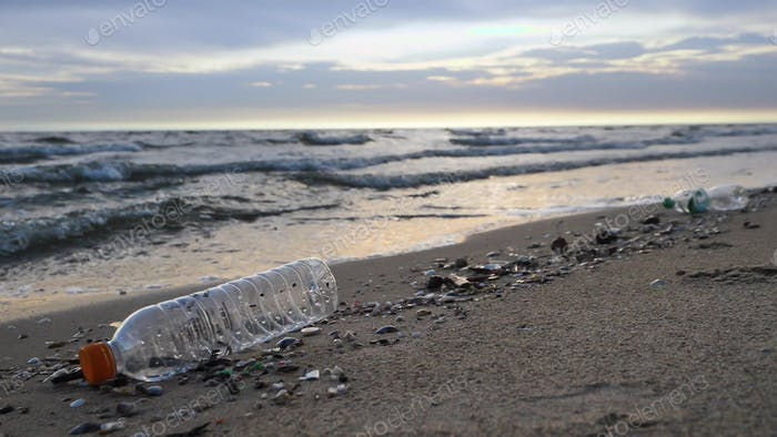 Waste and plastic pollution on the beach. Environment concept
