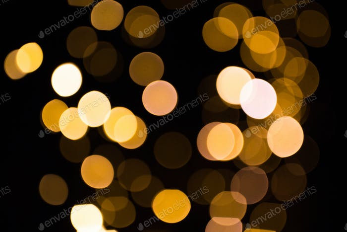blurred golden lights over dark background