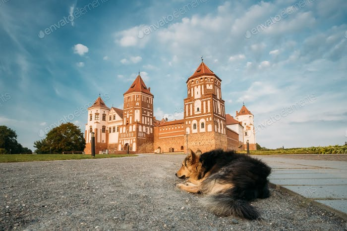 Mir, Belarus. Mir Castle Complex On Blue Sunny Sunset Sky Backgr