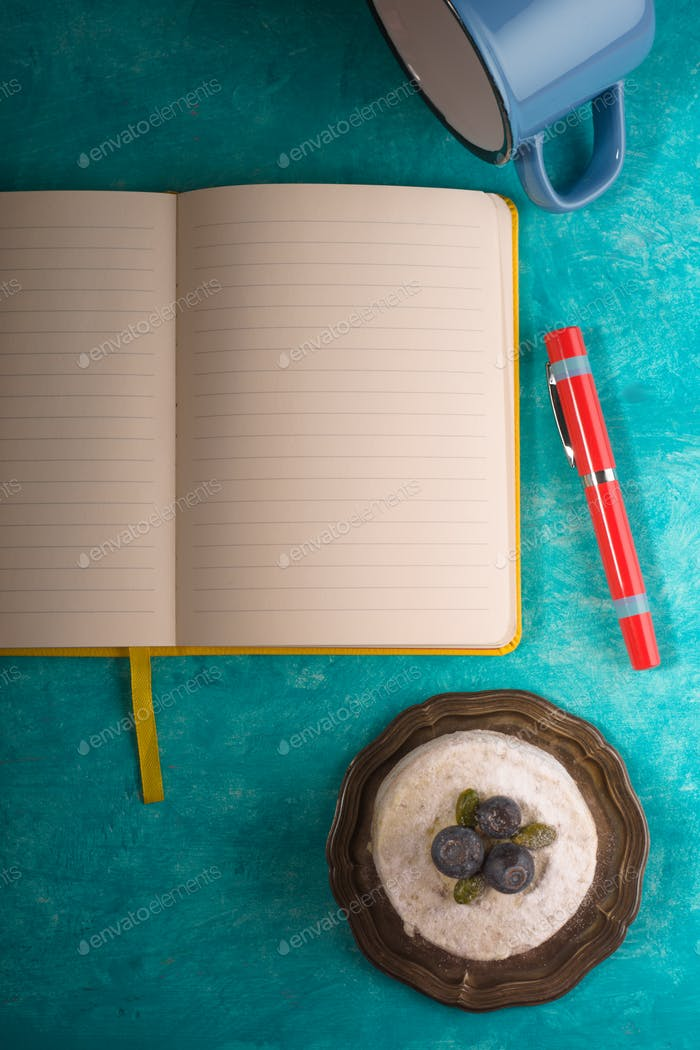 Cake , notebook , napkin and pen on background