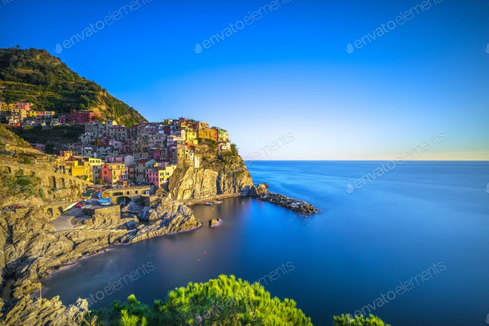 Manarola village, rocks and sea. Cinque Terre, Italy. Long Expos