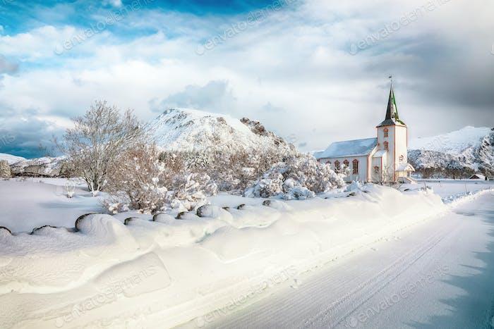 Splendid snowy winter scene of  Valberg church on Lofoten Islands.