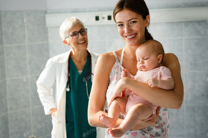 Portrait of happy mother with baby, medical pediatrician doctors, nurse