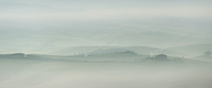 Pastel landscape in the early morning in Tuscany