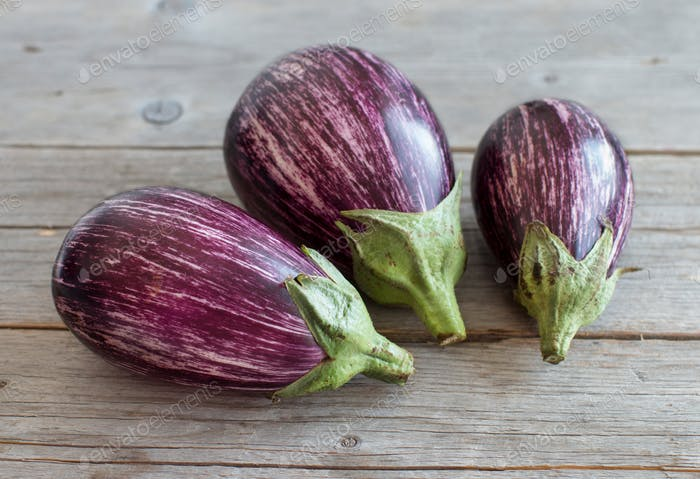 Fresh Raw striped eggplants