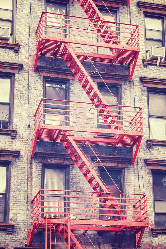 Residential building fire escape in Manhattan, New York, USA.