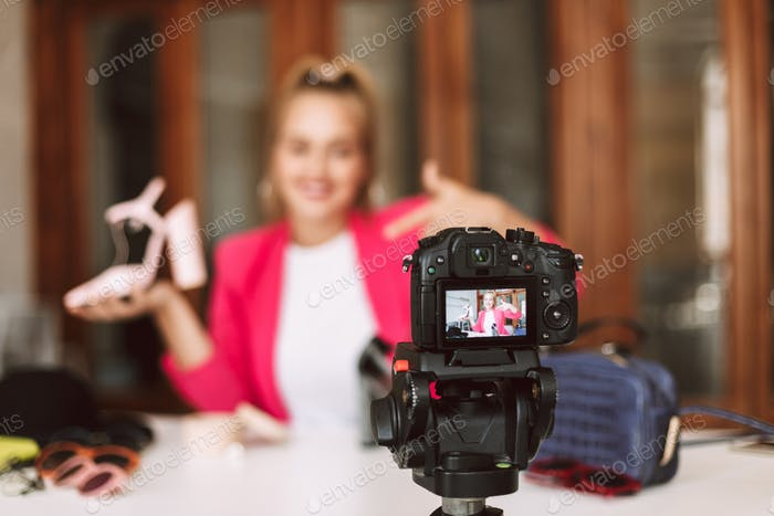 Close up black camera recording new fashion video isolated