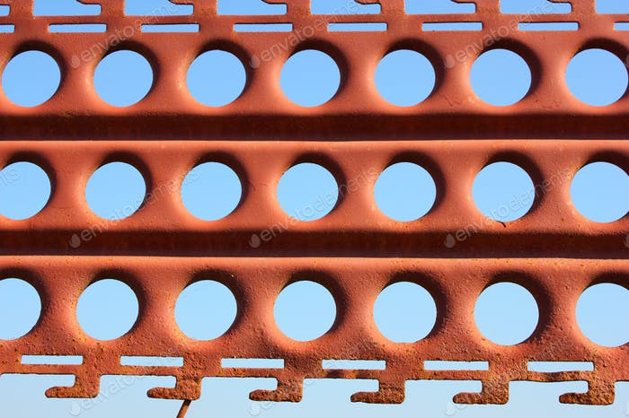 An Old Rusty Fence With Holes