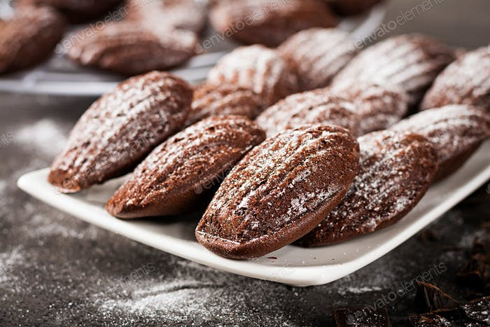 Chocolate cookies. Homemade Chocolate Madeleines on dark table. French cuisine.