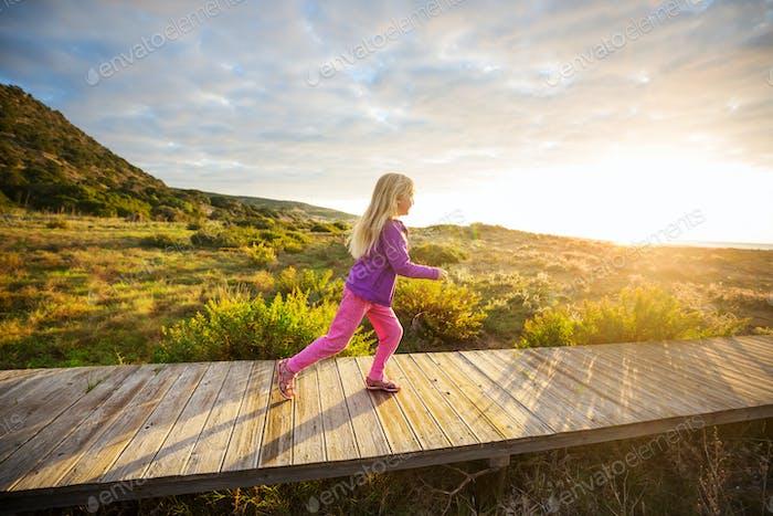 Girl on boardwalk