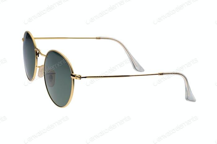 Gold frame round black sunglasses isolated on white