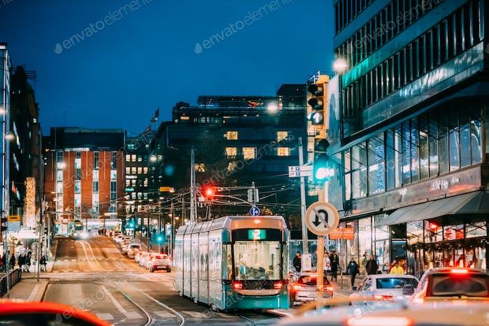 Helsinki, Finland. Tram Departs From A Stop On Kaivokatu Street