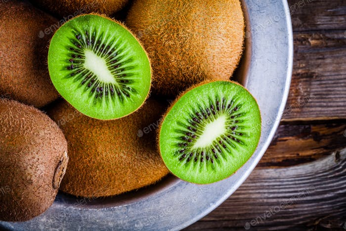 organic fresh juicy kiwi on dark wooden background