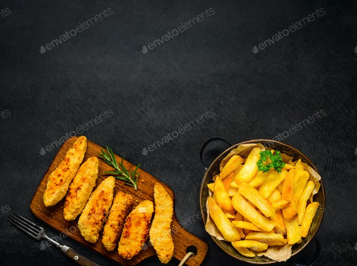 Chicken Fingers with French Fries and copy Space Area