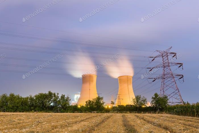 power plant on farmland at night