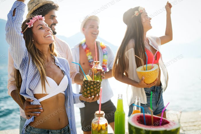 Summer, vacation, party, people concept. Group of friends having fun and party on the beach