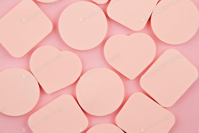 Makeup foundation sponges over pink background