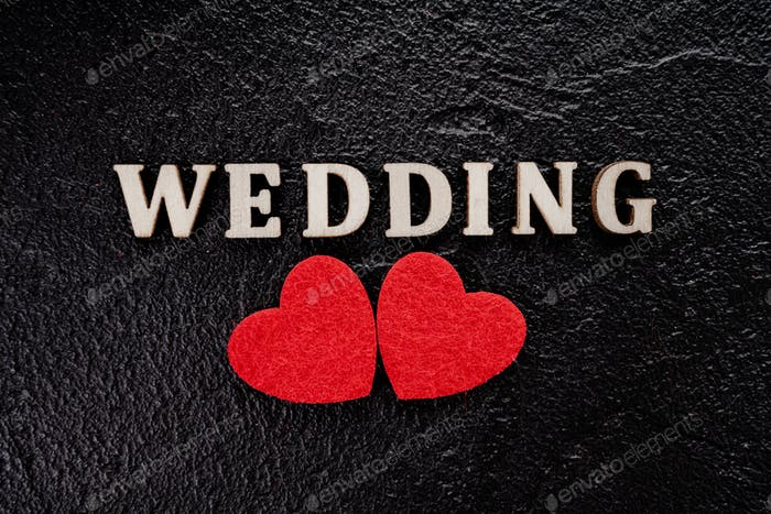 red heart. wedding concept on black background