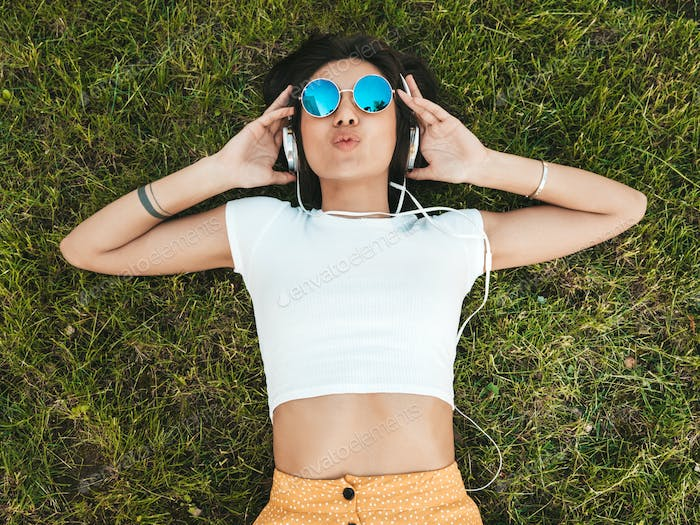 Portrait of young stylish woman posing outdoors