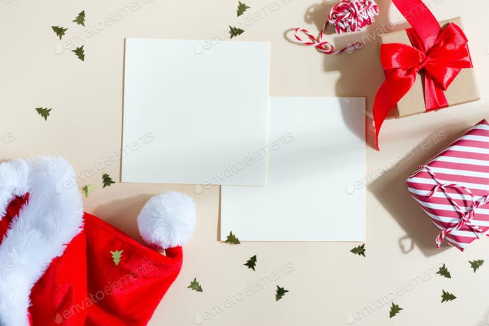 Christmas greeting card with red hat and gifts boxes