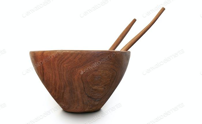 Leere Holzschale mit Löffel und Gabel