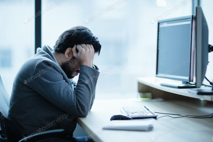 Depressed upset office worker having a headache problem