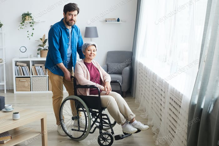 Disabled woman with caregiver