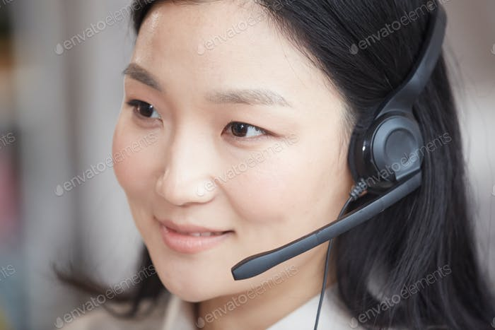 Smiling Asian Operator Wearing Headset