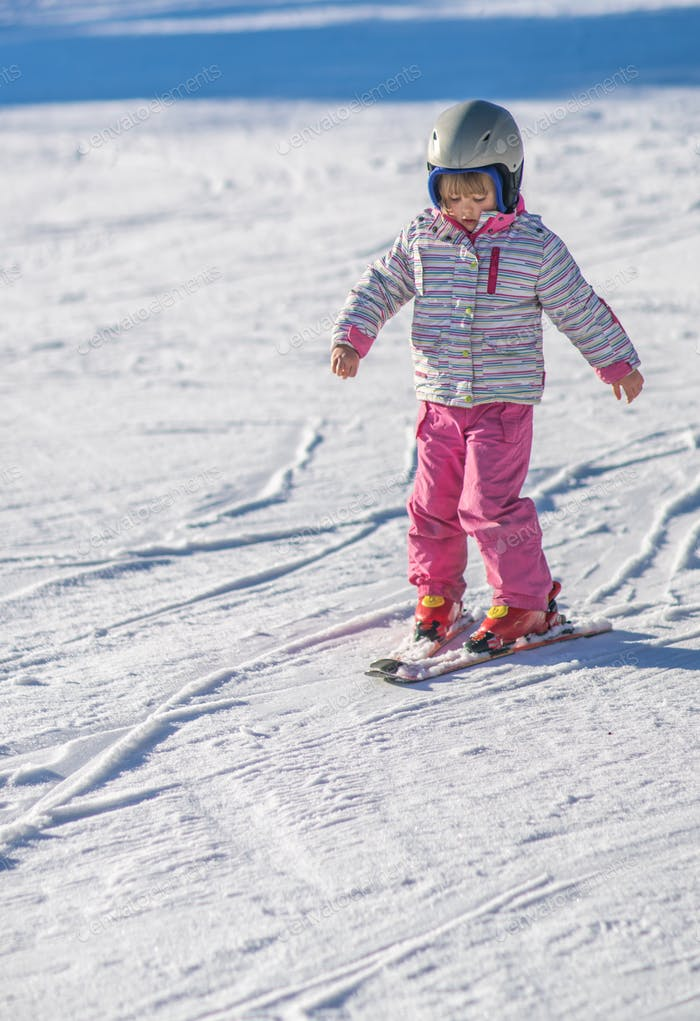 Little girl skiing for the first time