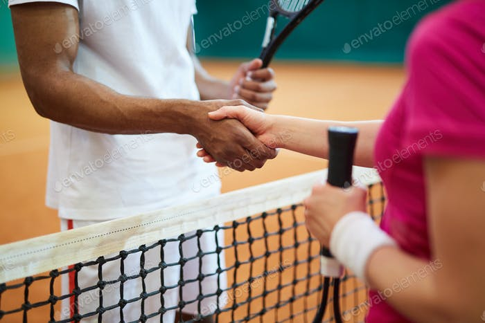 Handshake of tennis players