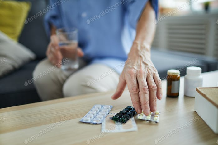 Senior Woman Taking Pills
