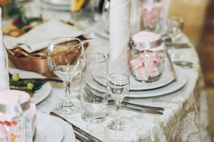 Beautiful decorated setting on centerpiece table with stylish plate
