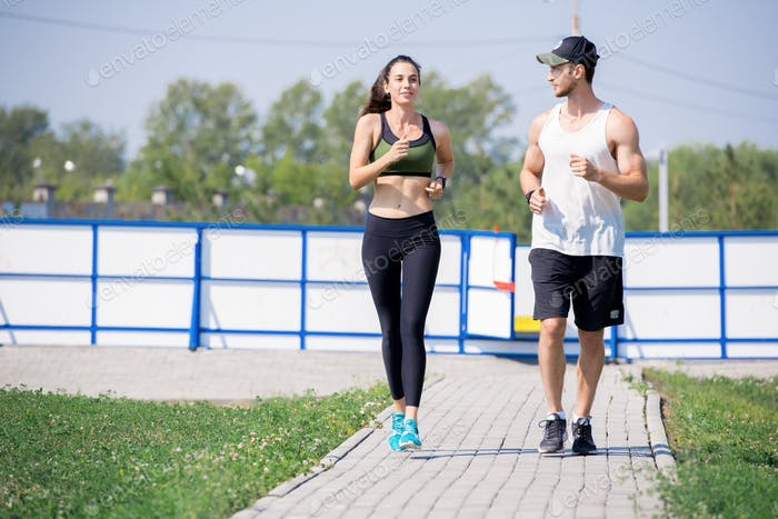 Active Young Couple Jogging
