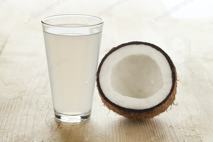 Coconut with a glass of coconut water