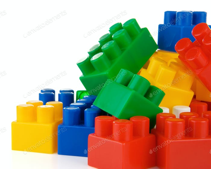 colorful plastic toys and bricks isolated on white