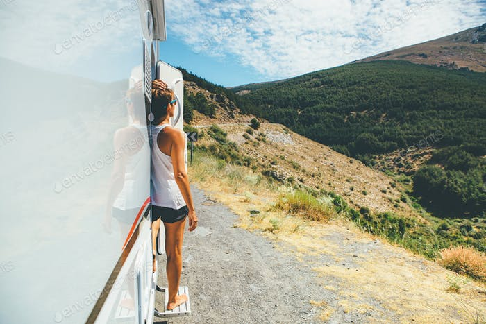 Girl enjoys the view on a motor home