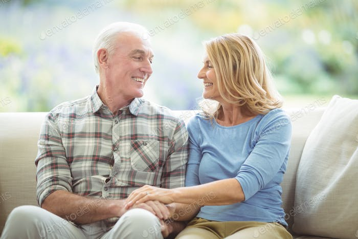 Senior couple sitting together on sofa in living room